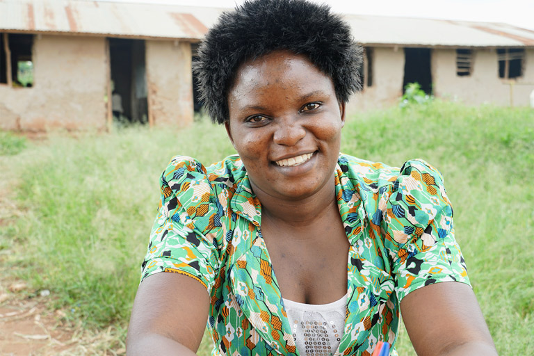 CEV Clementina smiles for the camera in front of her school