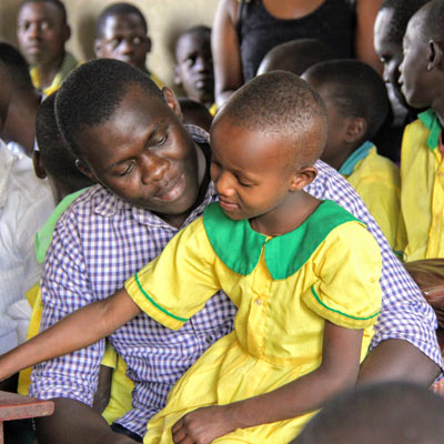 A student sitting on a Fellow's lap