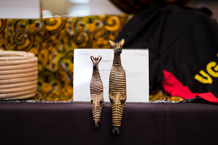 A pair of zebra sculptures sit perched on the silent auction table