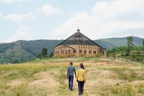 Fellows walk up a hill towards a church