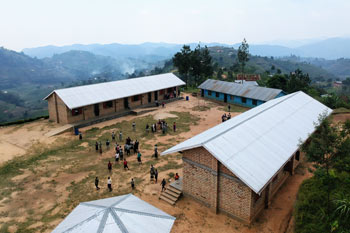 Overhead view of a full Building Tomorrow Primary School compound and the vast hills in the distance