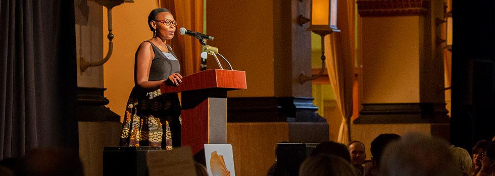 A Building Tomorrow ambassador addresses a crowded room