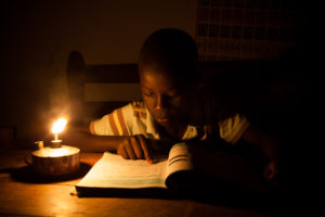 In Uganda, most families use kerosene to light their homes at night, exposing children and their families to adverse health risks and putting unsustainable pressure on the environment. (Image Source: SolarAid)
