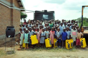 Students at the BT Primary School of Bulyamushenyi in Nakaseke District show off their new WASH hardware.