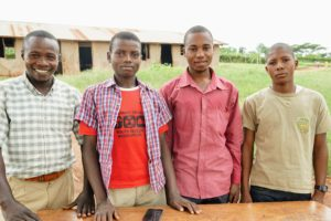 From left to right: Halerimana Apollinaire (CEV), Benjamin (student), Anthony Amutuhaire (English teacher), and Eritier (student)