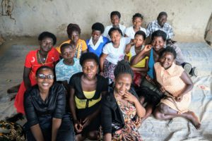 Embibo co-founders and Fellows Namata Tendo and Lucky Natukunda sit with a group of young women who are being trained in literacy and numeracy, alongside practical skills like hairdressing, to grow their own small businesses.