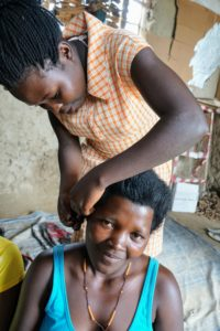 Alongside other complementary activiies, young women are taught the skill of hairdressing each week as a means for economic and social empowerment.